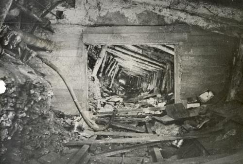 a black and white photograph showing some of the damage caused in a tunnel of the No. 4 mine as a result of the explosion of 1956.
