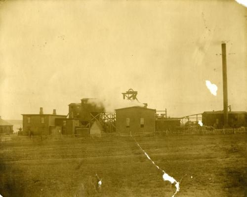 A sepia-coloured photograph of the buildings of Caledonia Number 4 colliery in Glace Bay, circa 1900 to 1920.