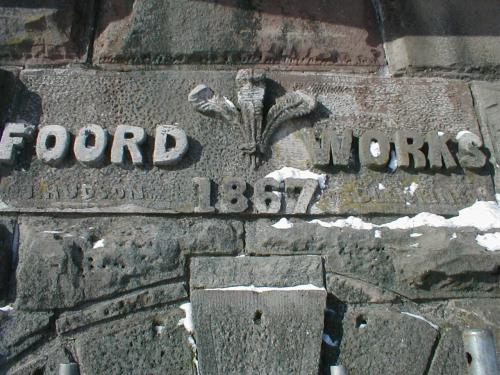 A colour photograph of the keystone of the Cornish Pumphouse which says Foord Works 1867. It includes a decorative emblem between the words Foord and Works.