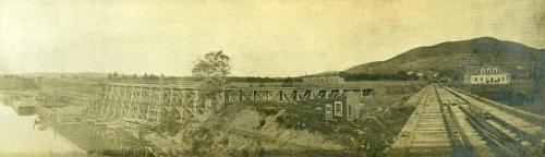 View of railway tracks and a shipping pier at Mabou Mines, circa 1915.