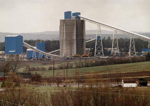 A colour photograph of the two coal silos, covered conveyor belts and other buildings of the Westray Mine, circa 1990.