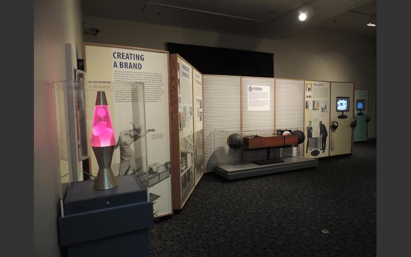 The exhibit explores how Clairtone embraced the groovy trends of the 1960s in marketing their first mass- produced stereo, the G2. Sales soared in Canada and the U.S.