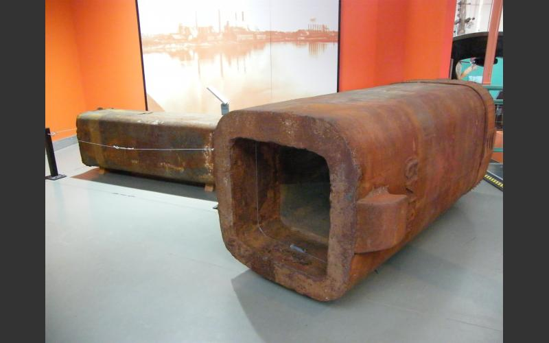 This is the ingot mould we are loaning to the Open Hearth Park on display in our exhibit. The park is on the site of the former Sydney steel plant. In the past, this plant produced half the steel in Canada.