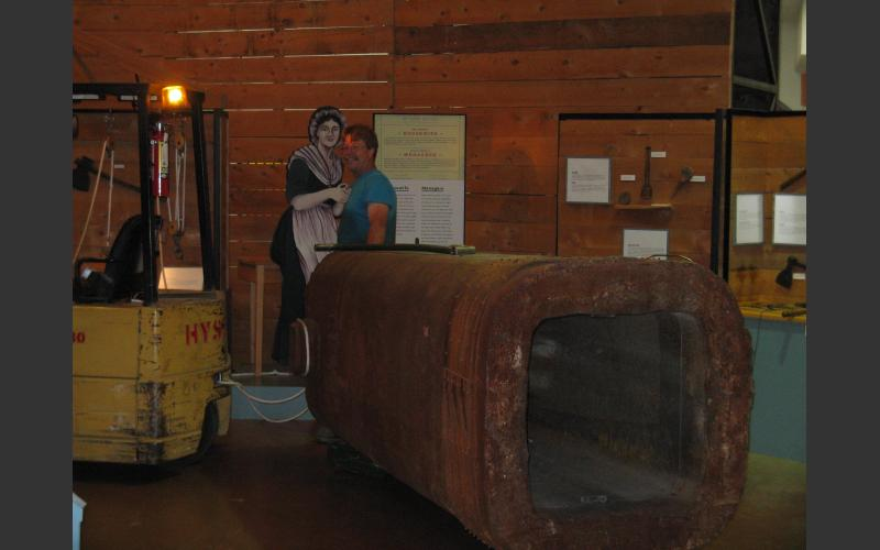 We moved it after hours through the exhibits with our (yellow) forklift and load skates underneath to help it roll along. All 10 tons!