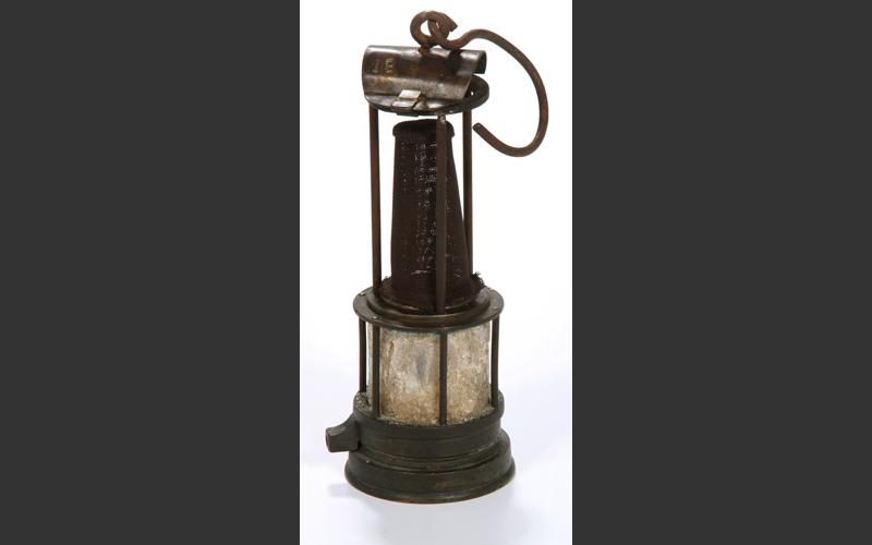 The Foord Pit suffered a terrible explosion in 1880 which killed 44 men. In 1927 a crew opening the Alan Shaft mine tunneled through to the site of the disaster and found the remains of some of the victims and relics like this lamp, its glass fused by the heat of the explosion.