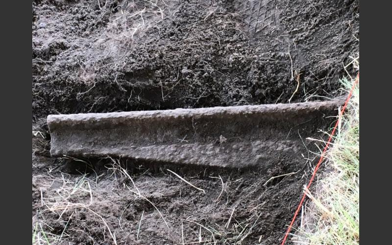"So far, this section of cast iron fish belly rail is the most interesting find. All four groups of diggers had participants who worked at exposing the rail. It is 74"" long."