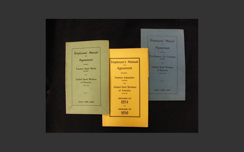 Various union agreements. These small booklets were distributed to all union members so that they would have access to information about their rights under the agreement.