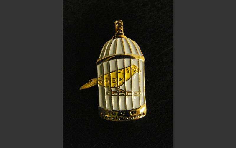 """This little lapel pin was part of the protest following the Westray mining disaster in Plymouth, N.S. in 1992. The families of the 26 miners killed and their supporters lobbied for improved worker safety legislation. The canary is a symbol related to mine safety and the legend at the bottom reads: """"USW Day of Mourning"""". Not currently on display"""