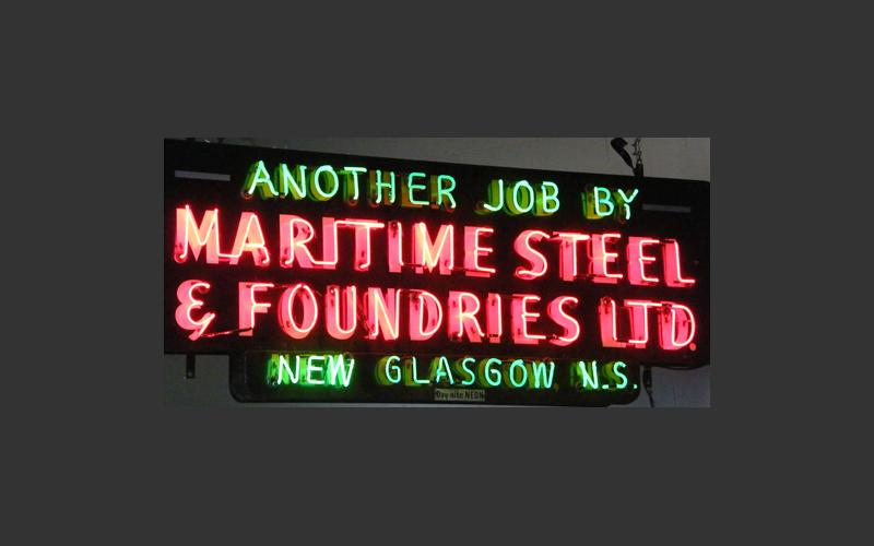 This neon sign hanging in our exhibit shows the New Glasgow, N.S. company's pride in their work.