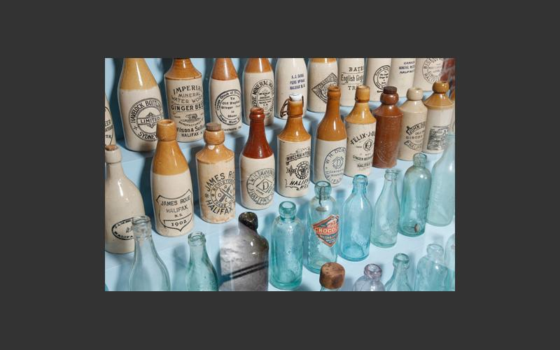 Nova Scotia soft drinks bottles. Some are made of pottery and some of glass. A wide range of flavours from ginger beer to orange pulpy was made in small shops across the province.