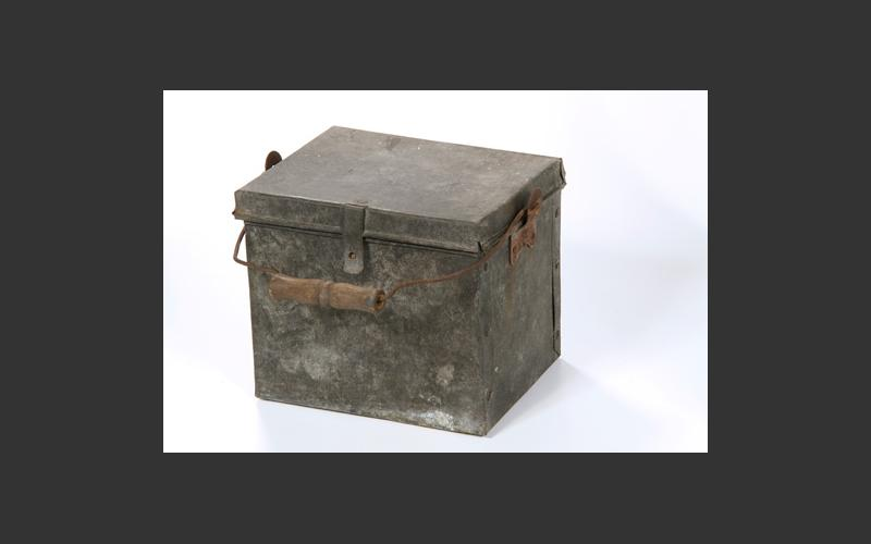 Not a lunch can; this is a shotfirer's powder box. The shotfirer created controlled explosions in the mine to remove rock and expose the coal.