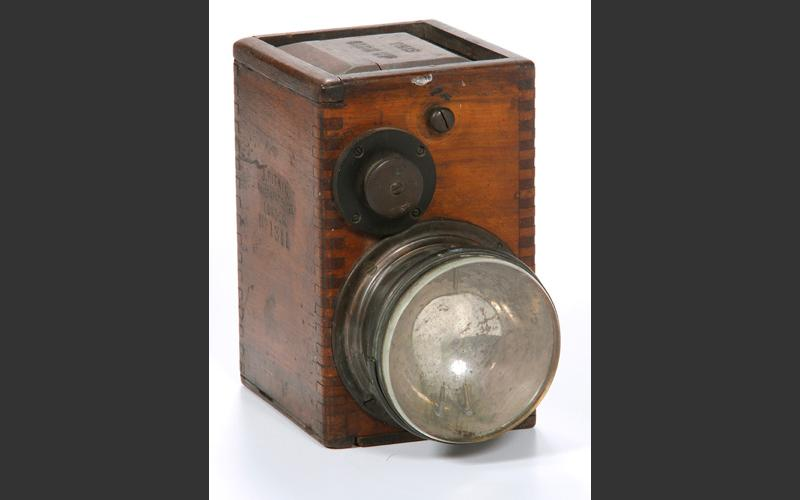 A draegerman's (mine rescuer) lamp housed in a wooden box.