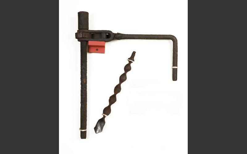 A hand-operated drill used to make a hole to stuff with explosives.