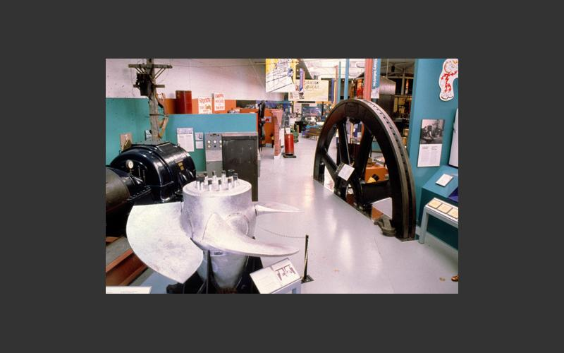 The shiny artifact on the left in our electricity exhibit is a Kaplin water turbine runner. It was from a hydroelectric power plant at Cowie Falls, Queen's Co., NS. and represents one of the ways we create electric power.