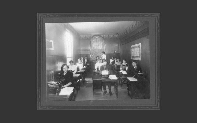 The typing class. This photo was taken at a Nova Scotia business school in the early 1920s. Note how few male students are in the class. The introduction of the typewriter brought many more women into offices starting in the late 1800s.