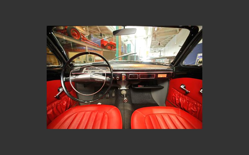 Although you can't climb inside, this is how the interior of our 1963 Volvo looks. The restored interior features red leather seats just like the day it rolled off the assembly line.
