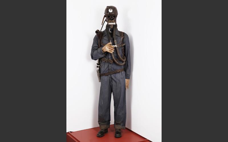 A mid-twentieth century draegerman in full rescue gear.
