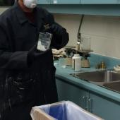 We are handling a caustic substance and so must take precautions.