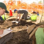 An archaeologist recorded changes in soil at each level and noted the location of objects as they were found.