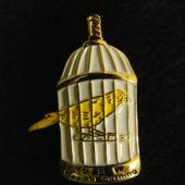 "This little lapel pin was part of the protest following the Westray mining disaster in Plymouth, N.S. in 1992. The families of the 26 miners killed and their supporters lobbied for improved worker safety legislation. The canary is a symbol related to mine safety and the legend at the bottom reads: ""USW Day of Mourning"". Not currently on display"