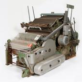 Carding machine for cotton from Dominion Textiles in Yarmouth. Part of the process of changing raw cotton into cloth, the carder uses bristled rollers to align the fibres to make the material ready for spinning.