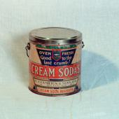 A tin for cream soda biscuits, one of 300 kinds made by G.J. Hamilton Bakery, Pictou. This large industrial bakery started in 1840 and by 1900 it was the largest and most modern biscuit factory in the region, shipping biscuits and confectionery as far as the West Indies.