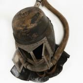 Early draegerman's helmet with breathing hoses attached.