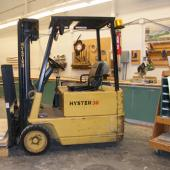Our little yellow forklift can lift up to 3000 pounds